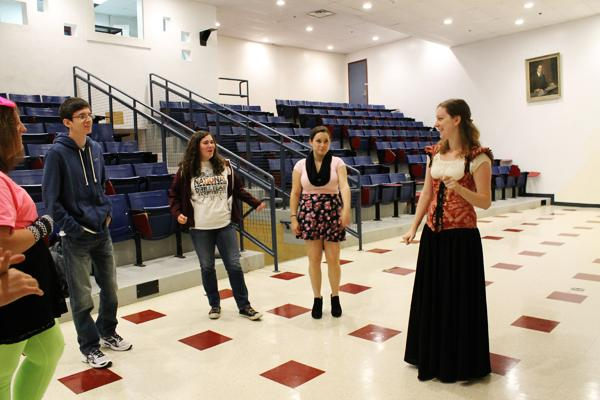Ms. Jessica Ruggles (right) works with her  theater students.