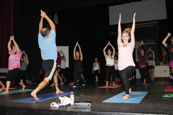 Physical education teacher Mr. John Sperry (left)  leads a group of GHS students in a yoga class.