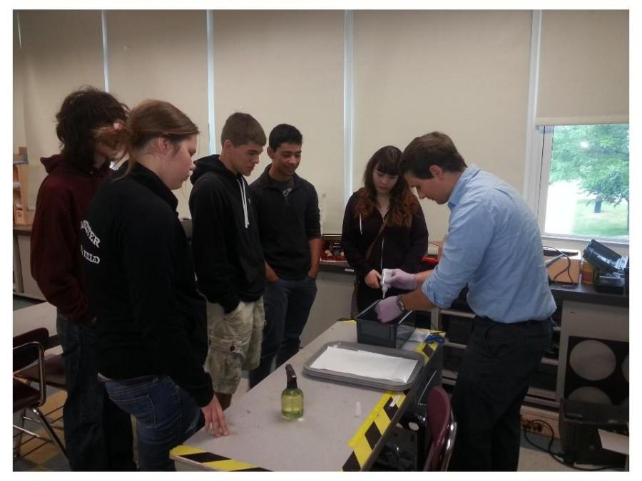 Science+teacher+Mr.+John+Barry+demonstrates+new+equipment+to+his+students.