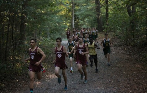 Everest Crawford (left) leads the boys cross country team at Lynn Woods.