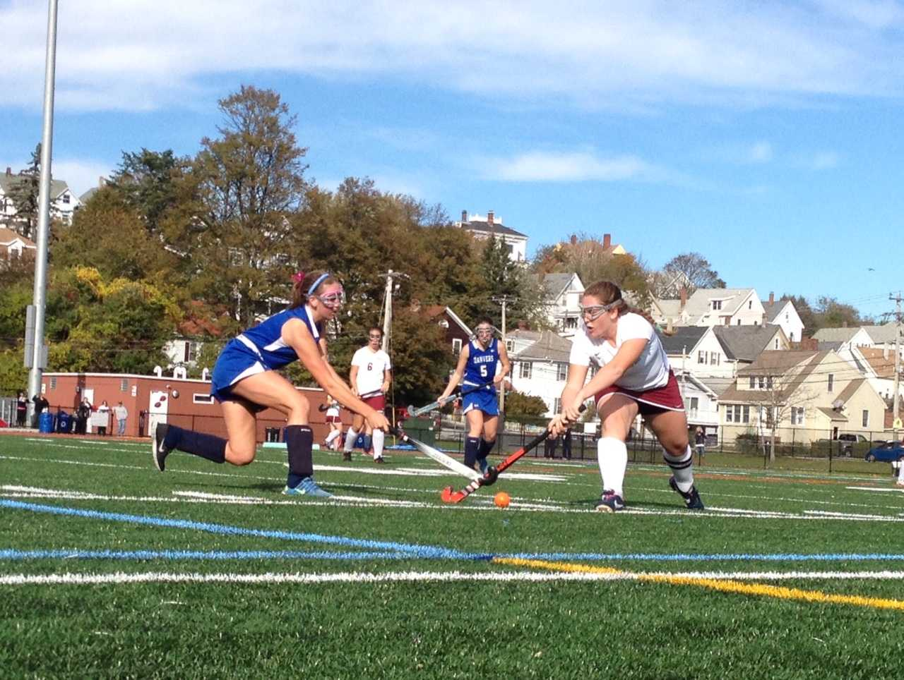 Chloe Flavin fights for position against Danvers defender