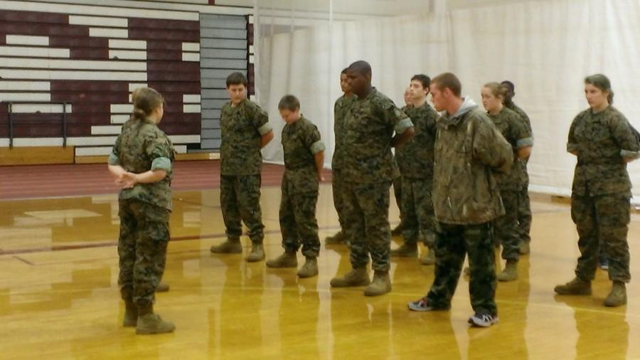 An E Block ROTC class is briefed before uniform inspection.