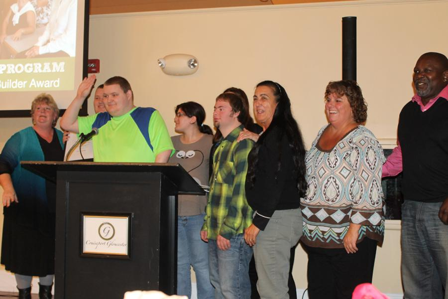 Transition program students and staff accept award for community service.
