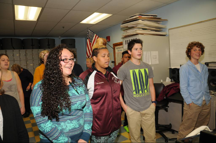 GHS chorus members Sara Corchado, Carrington Davis, Henry Hardy and Jack Favazza rehearse for their upcoming winter concert