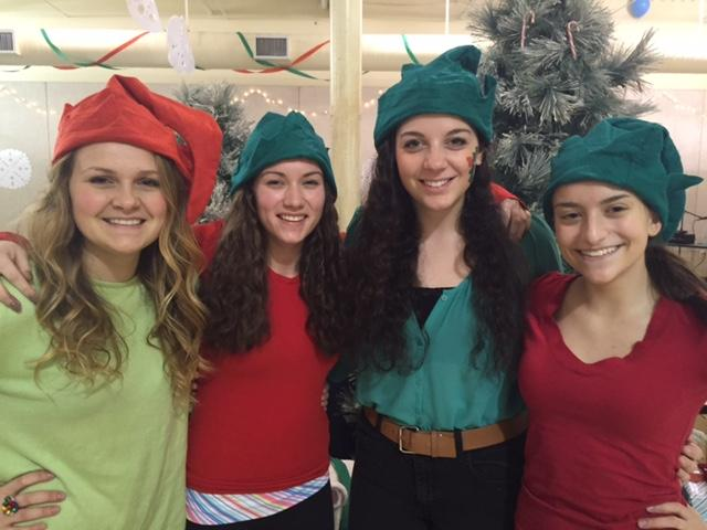 Ella Bonfield, Emily Russo, Kate Parisi, and Rachael Shahin at the Pathways holiday party