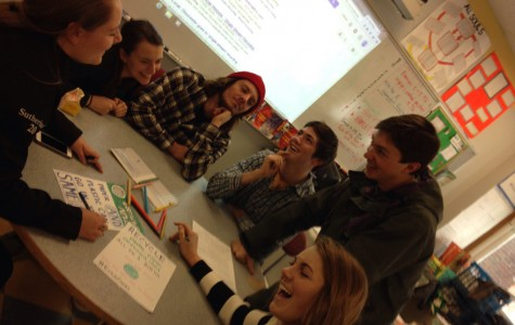 (from left) Brianna Sutherland, Rachael Shahin, Dylan Craaybeek, Winslow Lewis, Andrew Grammas and Laura Johnson make posters to promote the new recycling system