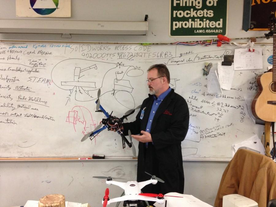 Coach L. demonstrates the aerodynamics of a quadcopter