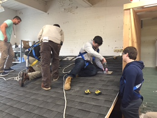 Electrical students training for solar panel installation