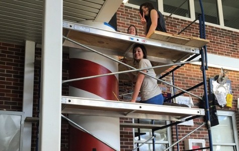 Danielle Bauke, Sarah Burnham  (top) Elizabeth Silveira and Jessalyn Silveira paint a lighthouse mural in the atrium