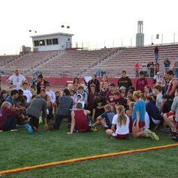 Coach Jeff Destino encourages track team after a hard loss