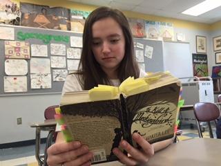 Freshmen Haley Johnson reads her favorite novel To Kill A Mockingbird
