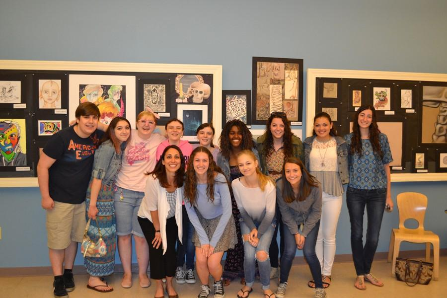 Honors+Art+students+pose+with+thier+teacher+Lorrinda+Cerutti+%28front+left%29+at+the+honors+art+exhibit+at+the+Cape+Ann+Museum+