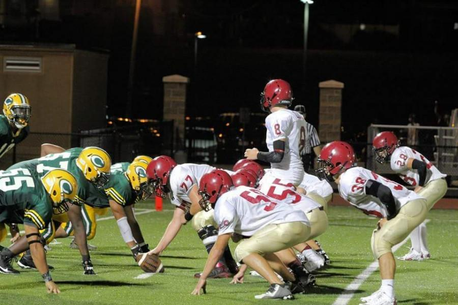 Fishermen take the line of scrimmage in last year's battle against Lynn Classical