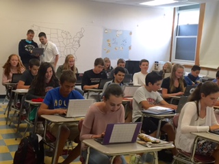 Freshmen history students working on Chromebooks