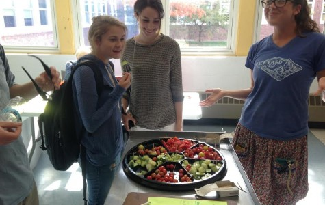 (From left) Megan Russo, Bella Tocantins, and Courtland Kelly offer a tomato tasting in the cafeteria