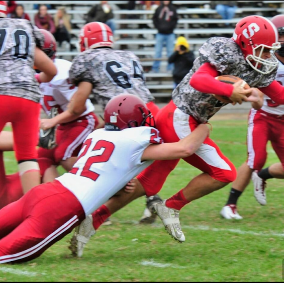 Senior defensive end John Philpott lunges for tackle for Saugus quarterback in their 43-0 victory last Saturday