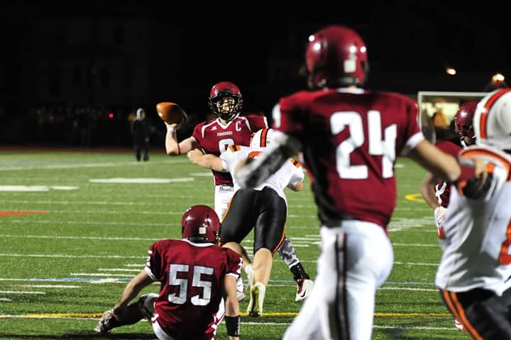 Quarterback Mike Cody (8) completes touchdown pass to Alex Militello (24) on the final play of Friday night's game