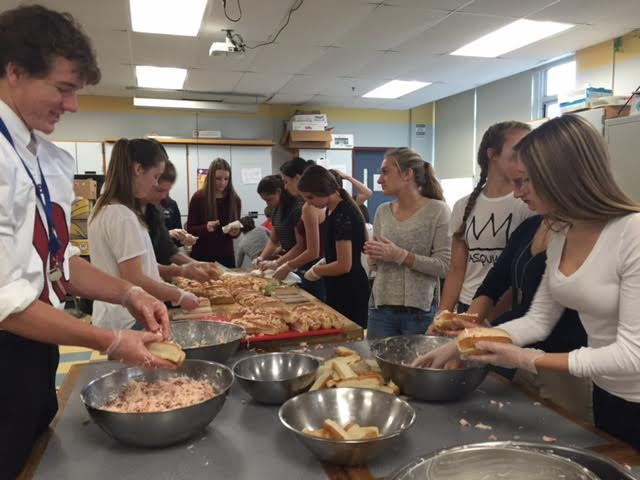 Members+of+interact+club+put+together+lobster+rolls+for+the+annual+fundraiser