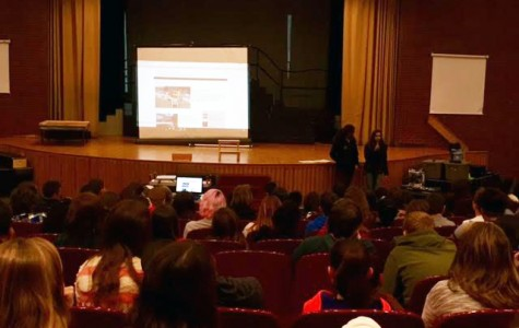 Jenna Taormina and Katelyn Moore tell eighth graders about cool it is to be a reporter for this awesome online newpaper