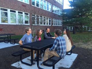 Seniors enjoy the new tables outside the cafeteria during lunch