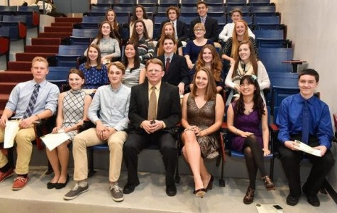 High-achieving students pose for a photo with Principal Erik Anderson on Wednesday night