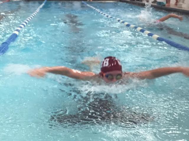 Ben+Callahan+warms+up+before+a+swim+meet+