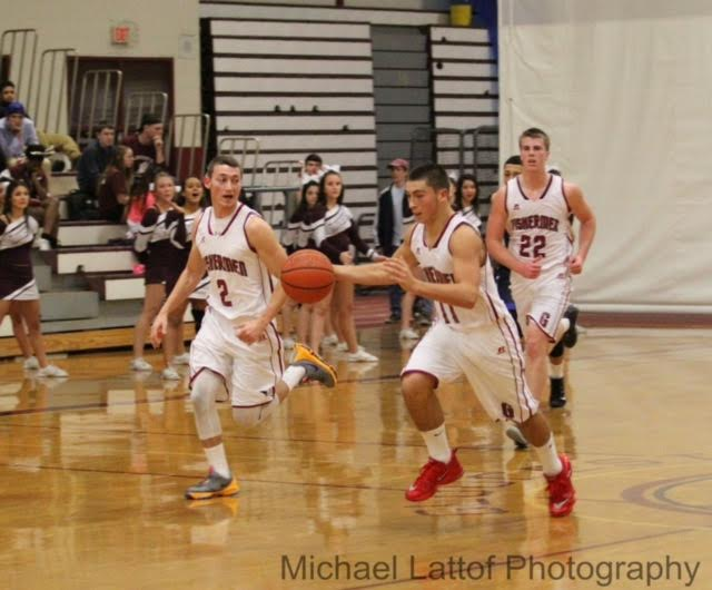 Marc Smith dribbles up the court with teammates Alex Militello and John Philpott