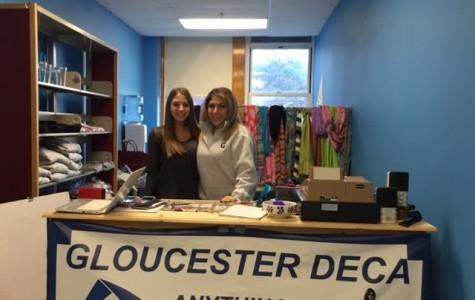 Juniors Brianna Ferrara, and Sonya Zappa reopen the DECA store