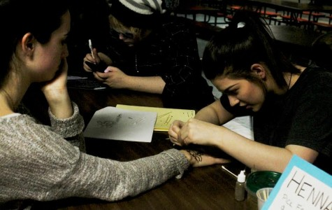 Alannah Allen gives henna tattoos at last weeks Art Club open-mic