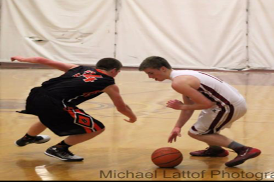 Senior John Philpott crosses up Beverly defender in a game earlier this season