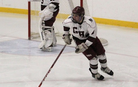 Junior Sal Costanzo carries the puck in the defensive zone