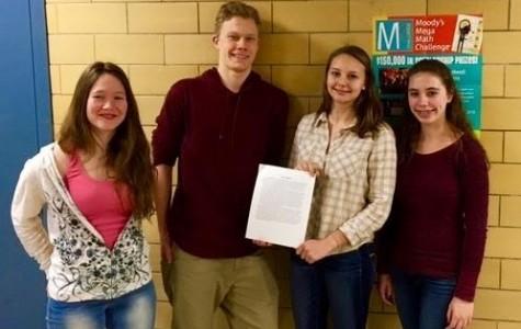 (From left) Danielle Bauke, Lukas Struppe, Matilda Grow and Sammy Orlando were awarded a $1000 scholarship for Moody's Mega Math Challenge
