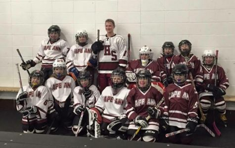 GHS senior Sara Francis (center) with future Fishermen girls hockey players at the Dorothy Talbot Rink
