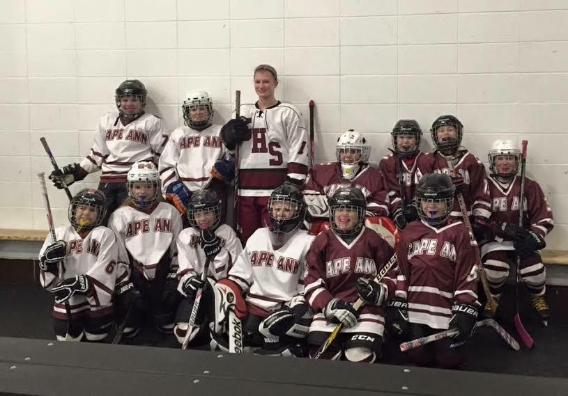 GHS senior Sara Francis (center) with future Fishermen girls hockey players at the Dorothy Talbot Rink