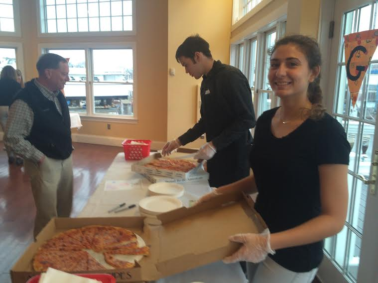 Alexia Marnoto and Steven Moody serve pizza lovers at Interact Club's  9th annual pizza taste-off
