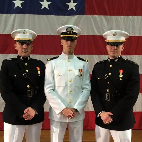 GHS graduate Evan Goss (center) was Commissioned an Ensign in the US Navy