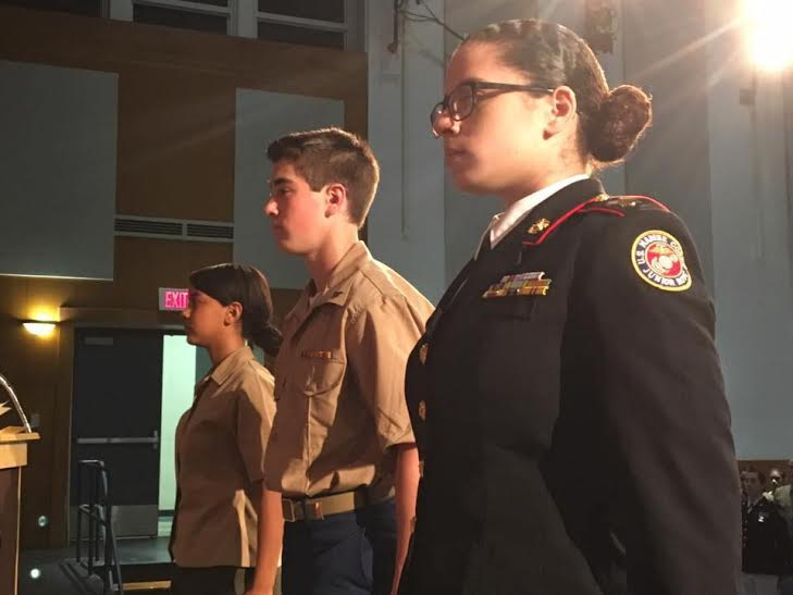 (From left) JROTC Cadets Raysa Zorrilla, Evan Sawyer, and Malia James stand at attention as they receive awards at the JROTC awards night.