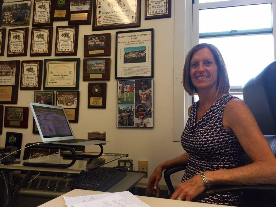 Julie Smith sits in her new office in the athletic wing