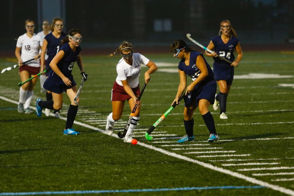 Senior Rachel Alexander weaves around Peabody defenders during Monday nights game.