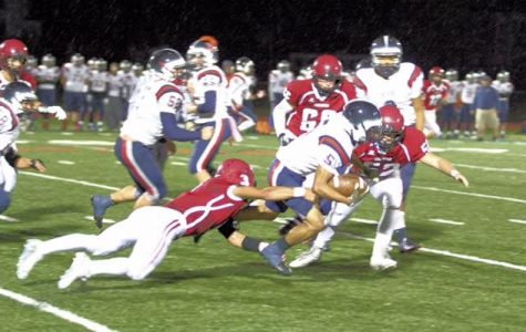 Senior captain Eric Cameron takes down Victor Rivera on Gloucester's five yard line
