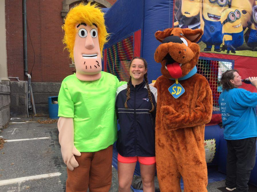 Corryn Ulrich poses with Shaggy and Scooby at the Mayor's Halloween party