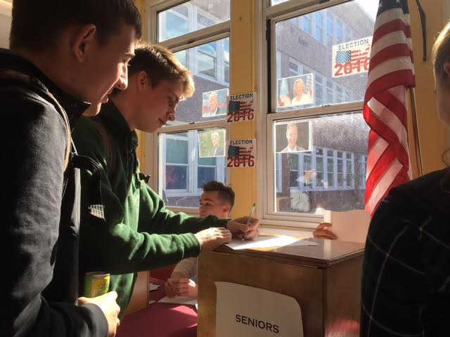 Jonathan Denman votes for president at the mock election on Tuesday