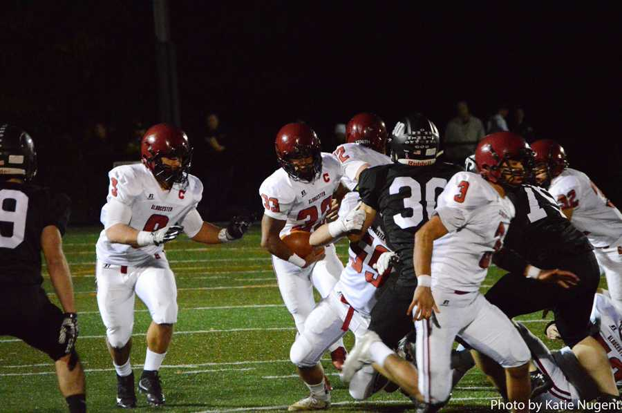 Captain Jermaine Edwards (33) rushes up the field after being handed the ball by Nate Young