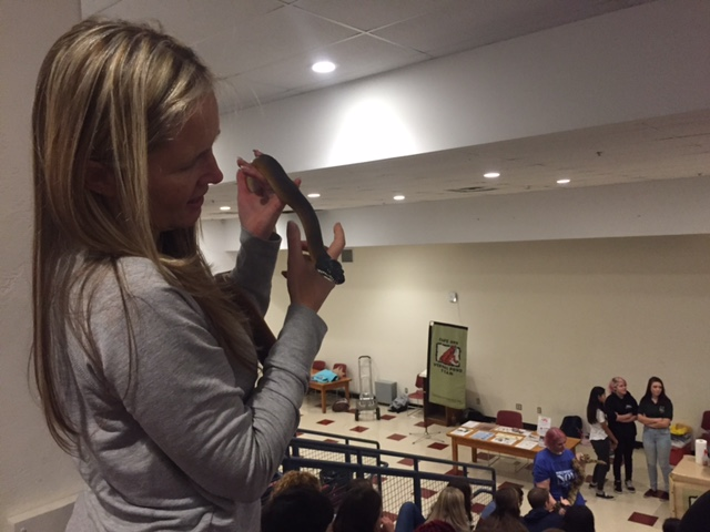 Jessica Lichtenwald bonds with one of the snakes from Friday's presentation