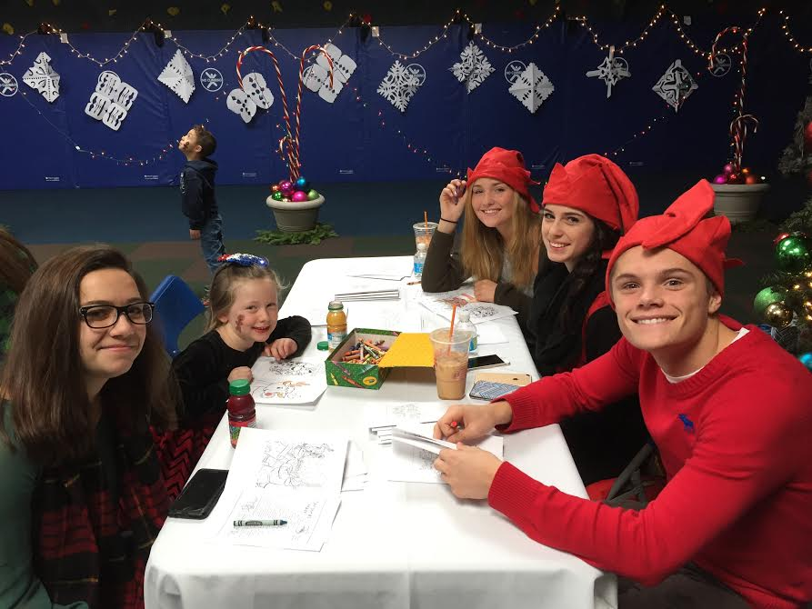 GHS students color with kids at the annual Interact Pathways Christmas party