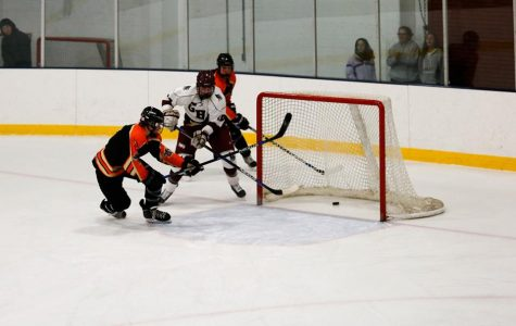 Boys hockey opens season with a win
