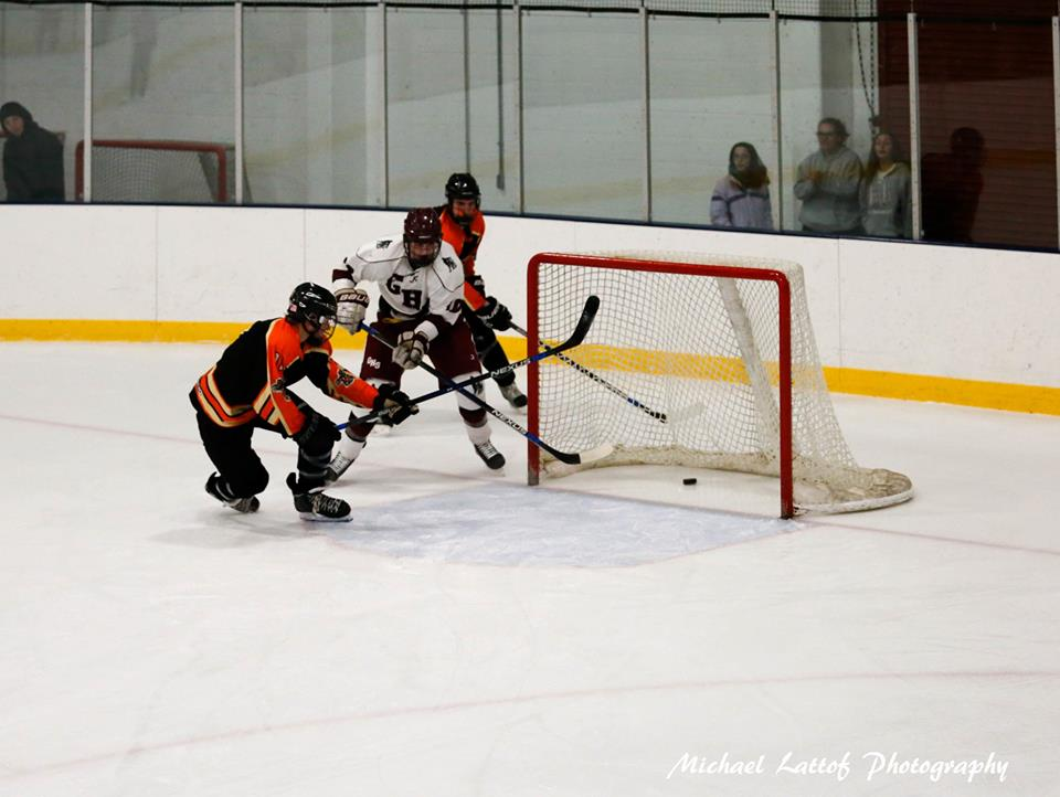 Senior Ethan Brennan scores on Beverly's open net in Wednesday's game last year.