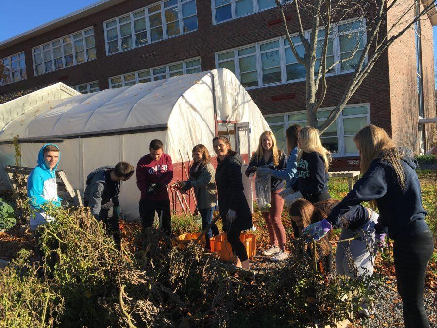 (from left) Jarrod Martin, Joao Ramalho, Tyler Parisi, Gabi Goszczynska , Macaella Oliver, Katie Nugent, Lexi Ciolino, Chrissy Nugent, Sophia Pata, and Sierra Rudolph practice their gardening skills