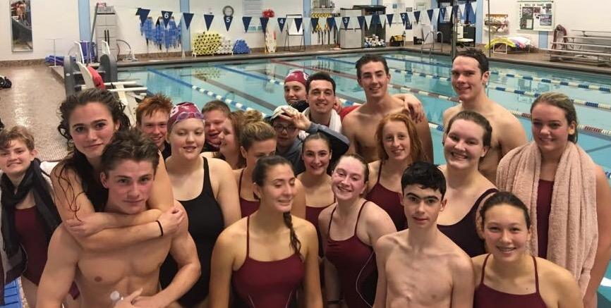 The+swim+team+smiles+for+a+photo+after+competing+at+the+Cape+Ann+YMCA+
