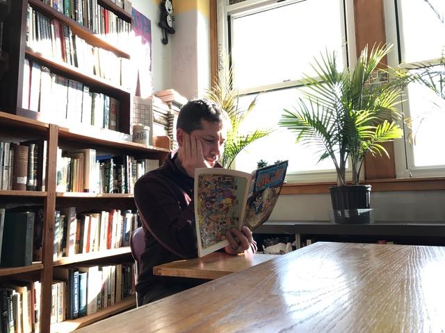 English teacher Zachary Roy reads one of his many comic books